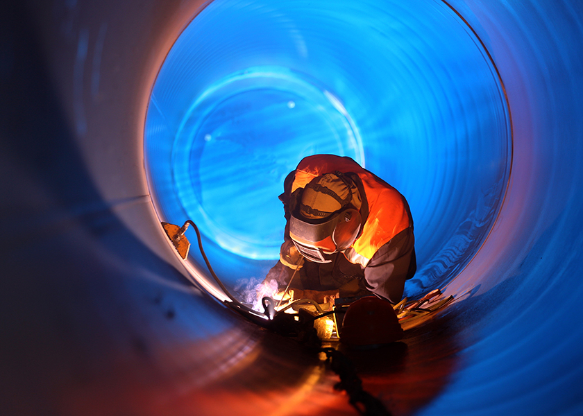Welder in Pipe Image